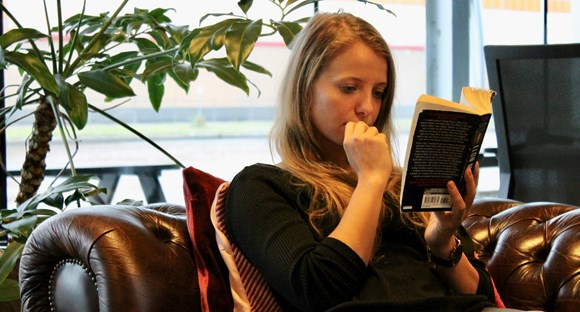 Daphne Tideman reading a book in RockBoost's office